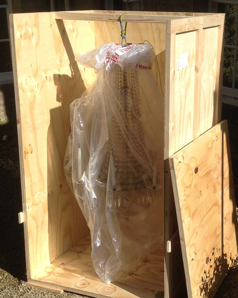 A chandelier wrapped and boxed for removal