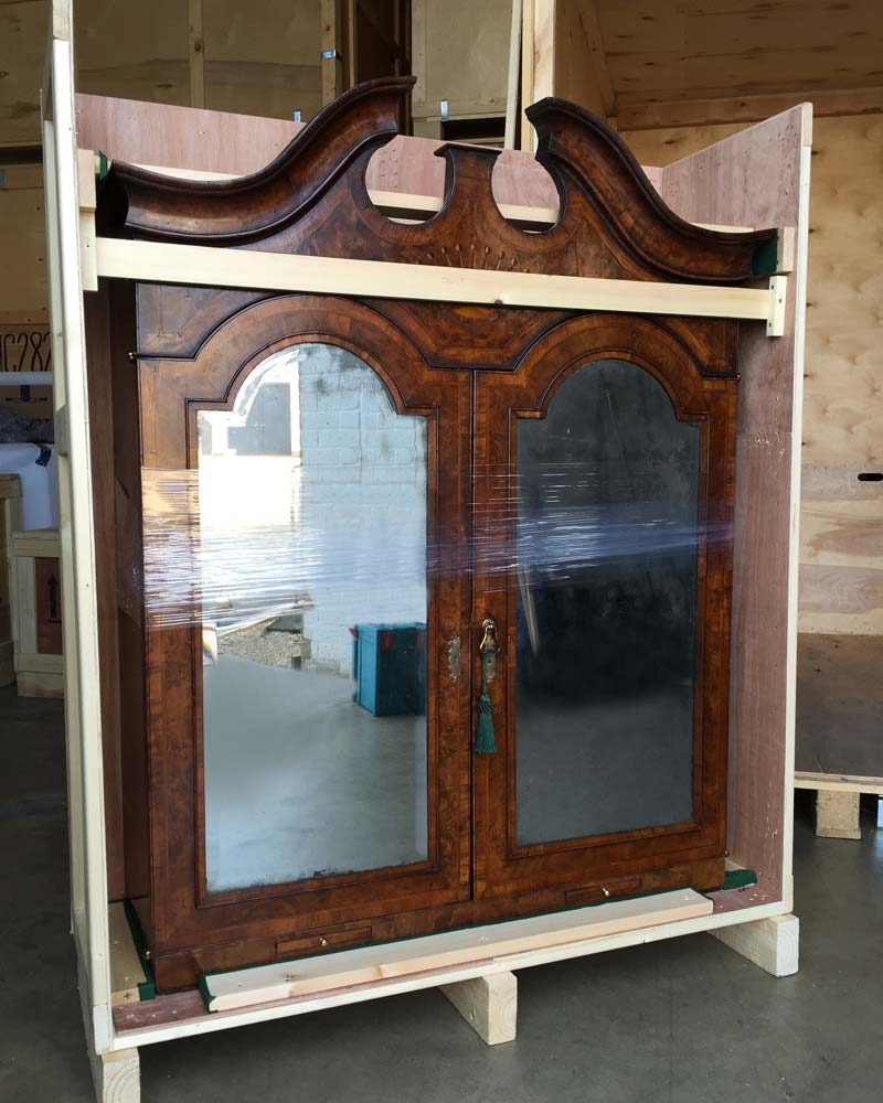 An antique cabinet packed securely for removal