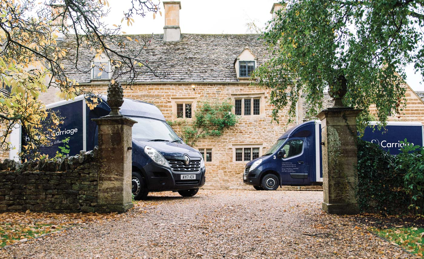 Two House and Carriage vans outside a property in the Cotswolds
